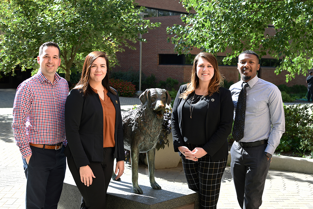 Academic Advocates by statue of True Grit